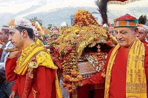 Priests taking the palanquin of Lord Raghunath to his temporary abode at Dhalpur, Kullu, on the occasion of world-famous Kullu Dussehra.
