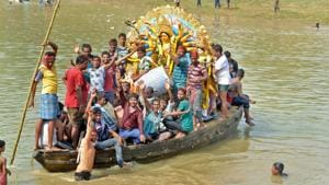 Devotees carry an idol of Goddess Durga for immersion in a river after the end of Durga Puja festival, on October 20, 2018.