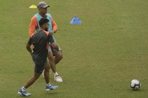 Indian cricketer Virat Kohli, foreground, and MS Dhoni play soccer during a practice session before the first ODI against West Indies.