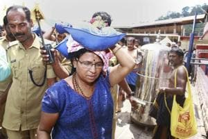 A female devotee who had trekked up with her family to Sabarimala temple, in Pathanamthitta, Saturday, Oct 20, 2018.