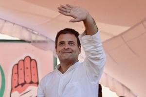 Congress president Rahul Gandhi waves to his supporters during a public meeting.