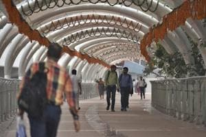 Commuters walk on the ITO Skywalk after its inauguration for general public on Monday, at Tilak marg Chowk in New Delhi, India, on Tuesday, October 16, 2018.