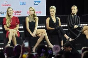 Petra Kvitova of the Czech Republic (2nd-L), Elina Svitolina of the Ukraine (2nd-R) and Kiki Bertens of the Netherlands (R) attend the official draw ceremony and gala of the WTA Finals Singapore.