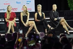 Caroline Wozniacki of Denmark (L), Petra Kvitova of the Czech Republic (2nd-L), Elina Svitolina of the Ukraine (2nd-R) and Kiki Bertens of the Netherlands (R) attend the official draw ceremony and gala of the WTA Finals Singapore