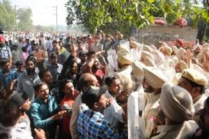 People protest after the Amritsar train accident on Saturday.