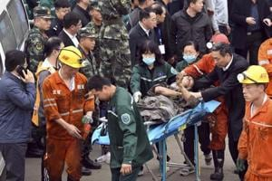 A worker is carried on a stretcher out of Longyun coal mine in Yuncheng county.