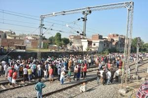 People gather at the scene of an accident along railroad tracks in Amritsar on October 20, 2018, after revelers who gathered on the tracks were killed by a moving train on October 19.