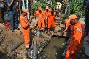 Police and NDRF personnel used deep divers and cutting instruments to cut off the cemented portions of the drain.