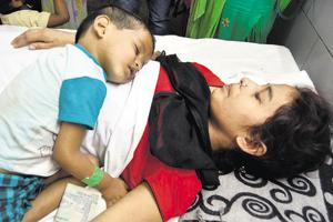 A boy, Arush, with his mother Preeti, one of 43 injured, who are being treated at the Guru Nanak Dev Hospital.