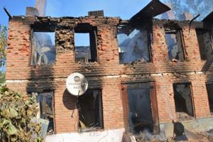 The frame of a house stands after an explosion damaged the building and killed seven civilians in Larro area of Kulgam, about 65 kilometres south of Srinagar in Jammu and Kashmir, on October 21, 2018.