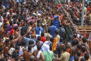 Protestors gather after a lady devotee trekked up with her family to Sabarimala temple, in Pathanamthitta, on October 20, 2018. Two women who reached the hilltop with a heavy police escort, had to turn back before reaching the sanctum sanctorum following protests by temple devotees.