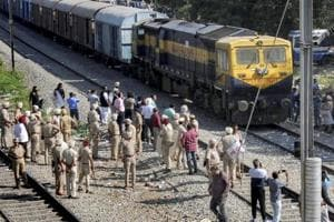Security on high alert as the first train passes by before resumption of railway services since the train accident, in Amritsar, on October 21, 2018.