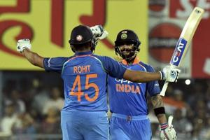 Guwahati: Indian cricketer Rohit Sharma celebrates his century with captain Virat kohli during the first One Day International cricket match against West Indies.