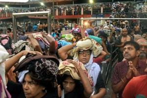 Devotees arrive to pay obeisance at Lord Ayyappa Temple in Sabarimala even as protesters keep women aged between 10 and 50 away despite the Supreme Court order.