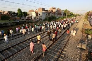 People gather at the site of an accident after a commuter train travelling at high speed ran through a crowd of people on the rail tracks on in Amritsar on October 20.