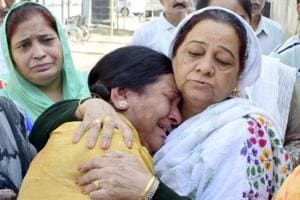 Relatives of a victim the train accident, Shiv Puri cremation ground, Amritsar, October 21, 2018