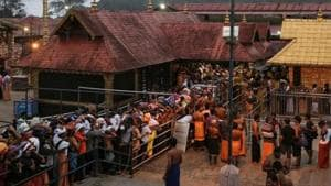Hindu devotees wait in queues inside the premises of the Sabarimala temple in Pathanamthitta district in Kerala on October 18.
