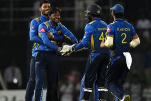 Sri Lankan cricketer Akila Dananjaya (2L) celebrates with teammates after he dismissed England cricketer Ben Stokes during the fifth and final one day international (ODI) cricket match between Sri Lanka and England.