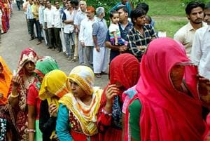 Voters waiting for their turn to exercise their franchise in the municipal corporation election at a poll booth in Jaipur's Chomu area.