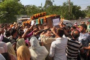 Army jawans carry the body of rifleman Rajat Kumar Basan, who was killed along the LoC, in Akhnoor sector.