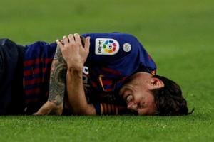 Lionel Messi reacts after fracturing his radial bone.