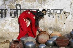 A girl collects drinking water from a tap in a village on the outskirts of Ajmer.