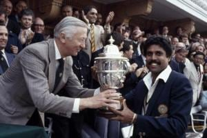 The captain of India, Kapil Dev, receives the Prudential World Cup Trophy from the Chairman of Prudential Assurance, Lord Carr of Hadley, after India