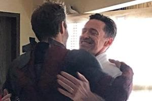 Ryan Reynolds and Hugh Jackman hug it out.