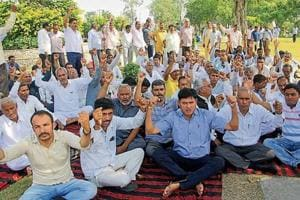 Striking Haryana Roadways workers staging a protest against the state government's policy to rope in 700 private buses in Rohtak on Tuesday.