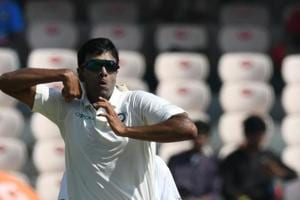 Indian cricketer Ravichandran Ashwin bowls during the first day
