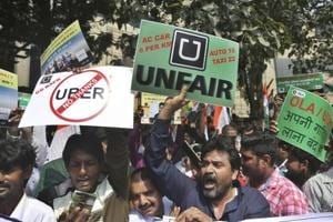 Drivers working for app-based taxis Uber and Ola protest outside Uber's office in Mumbai on Monday.