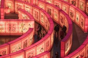 Chinese people walk in a maze at the Tang Paradise Park in Xi