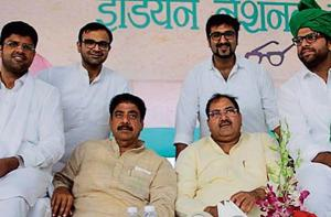 INLD leaders Dushyant Chautala (left) Ajay Chautala, (Sitting 2nd from left) Abhay Chautala, (sitting 3rd from left) and Digvijay Chautala during a rally in Bhiwani last year.