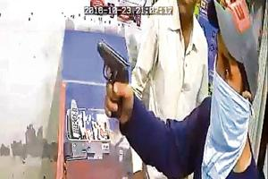 A video grab showing one of the robbers pointing gun at the money exchanger in Narinder Nagar locality of Ludhiana.