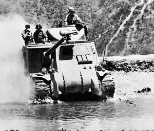 An M3 Lee tank crosses a river to meet the Japanese advance in March 1944 during the Battle of Imphal.