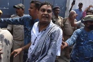 Police officials escort Brajesh Thakur, the main accused in the Muzaffarpur shelter home sexual abuse scandal, to a Muzaffarpur court in Bihar in August 2018.