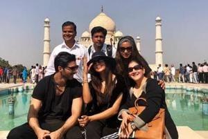 Sushmita Sen poses in front of the Taj Mahal with her team and rumoured boyfriend Rohman Shawl.