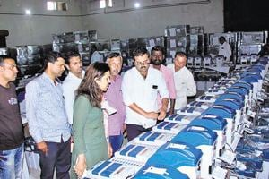 Deputy election officer Monika Singh (in green colour dress) at the administrative godown in Bhosari during the inspection of electronic voting machines, which were brought to Pune in the beginning of October.