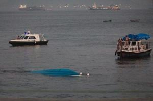 Rescuers tow the capsized boat on soon after the accident.
