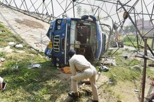 Patna: A police offical inspects at the accident site where a bus collided with an electric tower near Dhanki More, in Patna, Friday