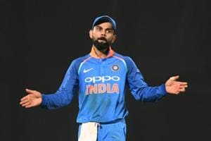 Indian cricket team captain Virat Kohli gestures towards the stands during the second one day international (ODI) cricket match between India and West Indies
