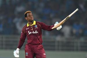 West Indies cricketer Shimron Hetmyer raises his bat after scoring a half century (50 runs) during the second one day international (ODI) cricket match between India and West Indies