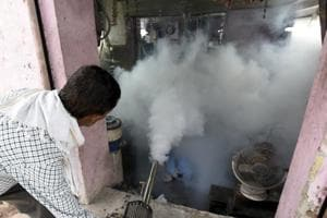 MCD workers conducting fogging operations in Delhi.