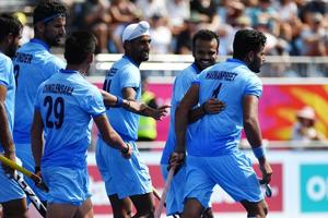 Harmanpreet Singh (R) of India is congratulated by his teammates after scoring his first goal during the men