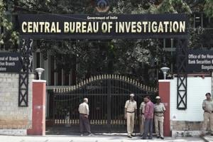 Security personnel stand guard outside the CBI headquarters, in Bengaluru on October 26.
