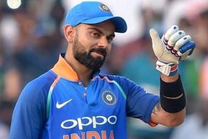 Virat Kohli reacts after completing his 10,000 runs in ODIs