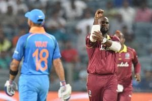 West Indies bowler Ashley Nurse (C) celebrates after taking the wicket of India batsman Shikhar Dhawan during the third one day international (ODI)