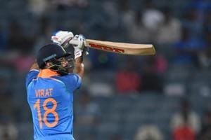 India captain Virat Kohli plays a shot during the third one day international (ODI) cricket match between India and West Indies at the Maharashtra Cricket Association Stadium in Pune