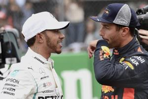 Red Bull driver Daniel Ricciardo (right) speaks to Lewis Hamilton after obtaining the first and third position respectively, during the qualifying session of the Formula One Mexico Grand Prix.