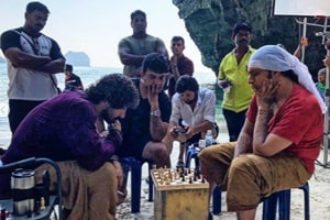 Aamir Khan engaged in a game of chess on the Thugs of Hindostan set.